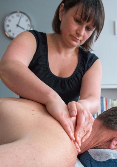 Ellie Massaging Shoulder